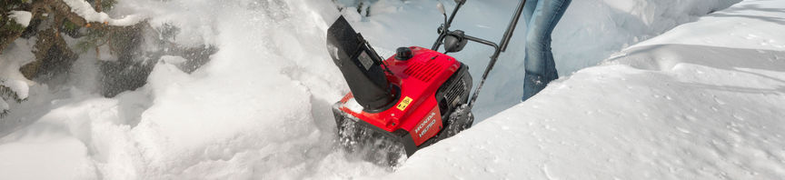 Snowthrower being used by model, snow location.